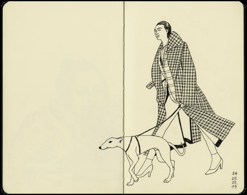 Mann in kariertem Mantel mit Windhund